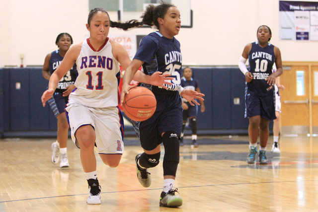 Reno guard Daranda Hinkey reaches in to steal the ball from Canyon Springs guard D'Licya Feaster during their Las Vegas Holiday Classic tournament game Saturday. (Sam Morris/Las Vegas Review-Journal)