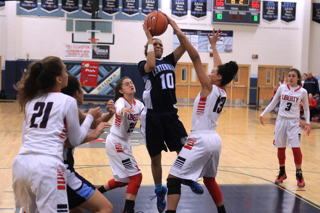 Centennial guard Jayden Eggleston drives the lane for the winning basket against Liberty during the championship game at the Las Vegas Holiday Classic on Tuesday. Centennial won the game 71-66. (S ...