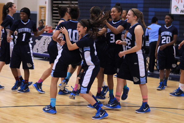 Centennial players celebrate as time expires in their championship game against Liberty at the Las Vegas Holiday Classic on Tuesday. Centennial won the game 71-66. (Sam Morris/Las Vegas Review-Jou ...
