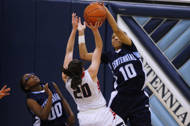 Centennial guard Jayden Eggleston blocks a shot by Liberty guard Kealy Brown during the championship game at the Las Vegas Holiday Classic on Tuesday. Centennial won the game 71-66. (Sam Morris/La ...