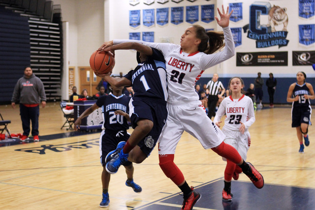Centennial guard Pam Wilmore is fouled by Liberty guard Kaily Kaimikaua during the championship game at the Las Vegas Holiday Classic on Tuesday. Centennial won the game 71-66. (Sam Morris/Las Veg ...