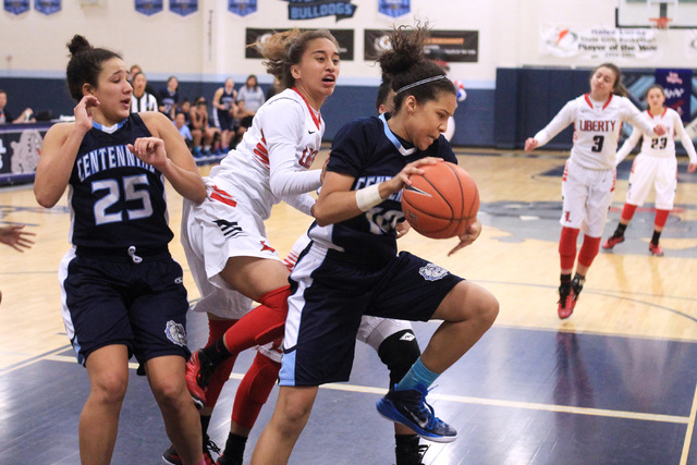 Centennial guard Jayden Eggleston pulls a rebound away from Liberty guard Kaily Kaimikaua to seal Centennial's 71-66 win in the championship game of the Las Vegas Holiday Classic on Tuesday. Eggle ...