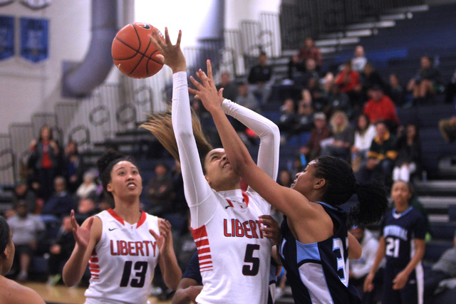 Centennial guard Megan Jefferson defends Liberty forward Jaelyn Royal during the championship game at the Las Vegas Holiday Classic on Tuesday. Centennial won the game 71-66. (Sam Morris/Las Vegas ...