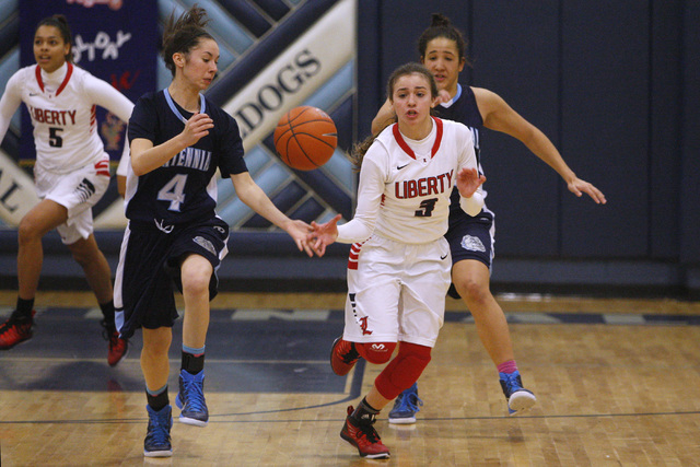 Centennial guard Courtney Walker fouls Liberty guard CeCe Quintino during the championship game at the Las Vegas Holiday Classic on Tuesday. Centennial won the game 71-66. (Sam Morris/Las Vegas Re ...