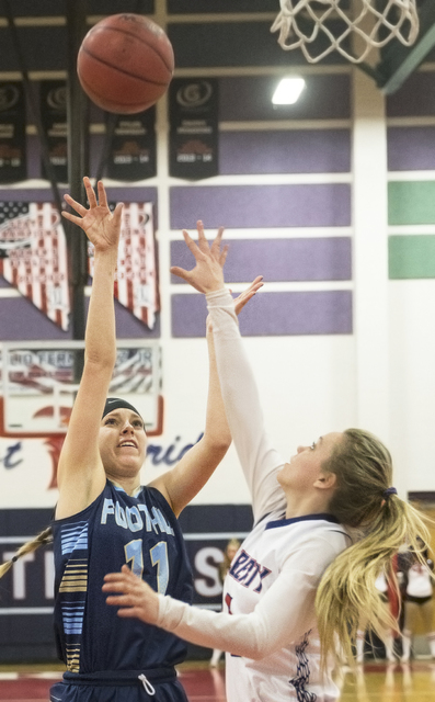 Foothill's Kylie Vint (11) shoots a jump shot over Liberty's London Pavlica (5) during the Falcons' road matchup with the Patriots  on Monday, Jan. 9, 2017, at Liberty High School, in Las Vegas. B ...
