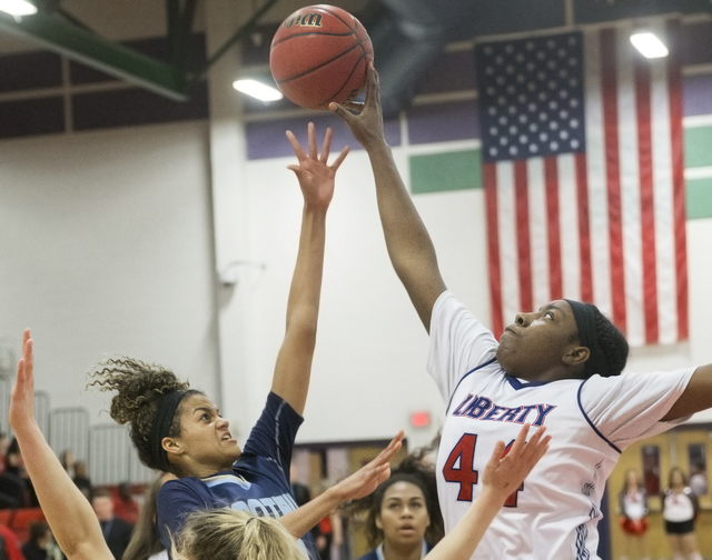 Foothills Rae Burrell (12) has her shot blocked by Liberty's Dre'una Edwards (44) during the Falcons' road matchup with the Patriots  on Monday, Jan. 9, 2017, at Liberty High School, in Las Vegas. ...