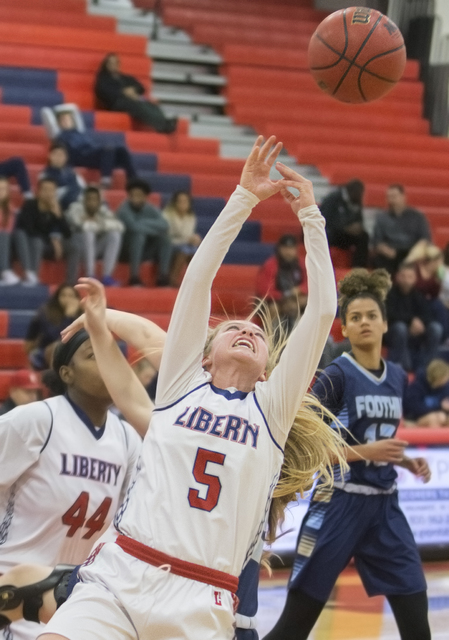 Liberty's London Pavlica (5) reaches for a rebound during the Patriots home matchup with the Foothill Falcons on Monday, Jan. 9, 2017, at Liberty High School, in Las Vegas. Benjamin Hager/Las Vega ...
