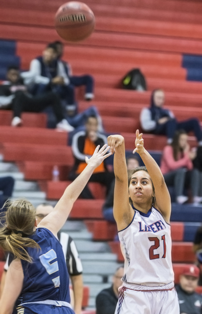 Liberty's Kaily Kaimikaua (21) shoots a three point shot over Foothill's Emily Capps (5) during the Patriots home matchup with the Falcons on Monday, Jan. 9, 2017, at Liberty High School, in Las V ...