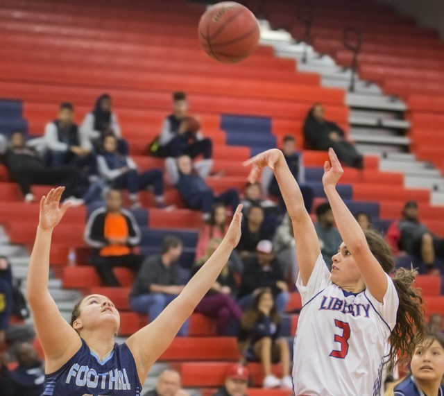 Liberty's Celine Quintino (3) shoots a jump shot over Foothills Emily Capps (5) during the Patriots home matchup with the Falcons on Monday, Jan. 9, 2017, at Liberty High School, in Las Vegas. Ben ...