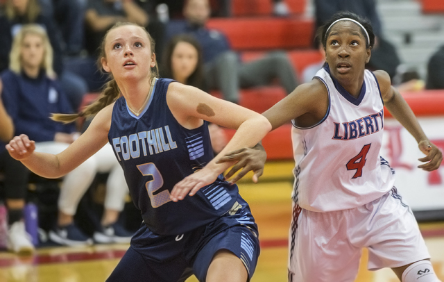 Liberty's Star Walker (4) fights for a rebound with Foothills Aqui Williams (2) during the Patriots home matchup with the Falcons on Monday, Jan. 9, 2017, at Liberty High School, in Las Vegas. Ben ...