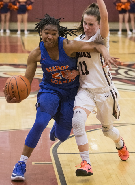 Bishop Gorman's Skylar Jackson (20) drives past Desert Oasis' Ashlynn Sharp (11) during the Gaels road matchup with the Diamondbacks on Tuesday, Jan. 10, 2017, at Desert Oasis High School, in Las  ...