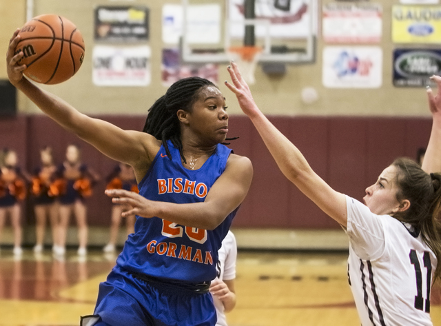 Bishop Gorman's Skylar Jackson (20) makes a pass around Desert Oasis' Ashlynn Sharp (11) during the Gaels road matchup with the Diamondbacks on Tuesday, Jan. 10, 2017, at Desert Oasis High School, ...