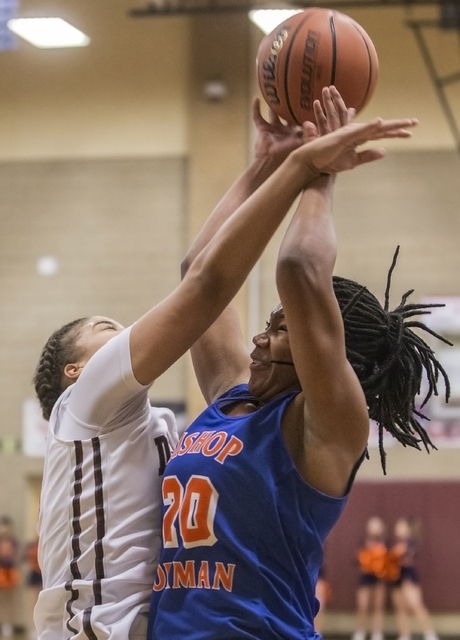 Bishop Gorman's Skylar Jackson (20) gets fouled while shooting a jump shot by Desert Oasis' Dajaah Lightfoot (35) during the Gaels road matchup with the Diamondbacks on Tuesday, Jan. 10, 2017, at  ...