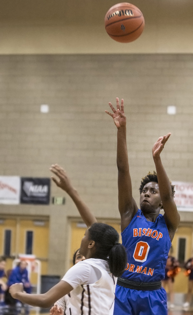 Bishop Gorman's Quinece Hatcher (0) shoots a three point shot during the Gaels road matchup with the Desert Oasis Diamondbacks on Tuesday, Jan. 10, 2017, at Desert Oasis High School, in Las Vegas. ...