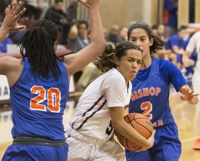 Desert Oasis' Eliyjah Pricebrooks (5) drives past Bishop Gorman's Skylar Jackson (20) and Shaira Young (2) during the Diamondbacks home matchup with the Gaels on Tuesday, Jan. 10, 2017, at Desert  ...
