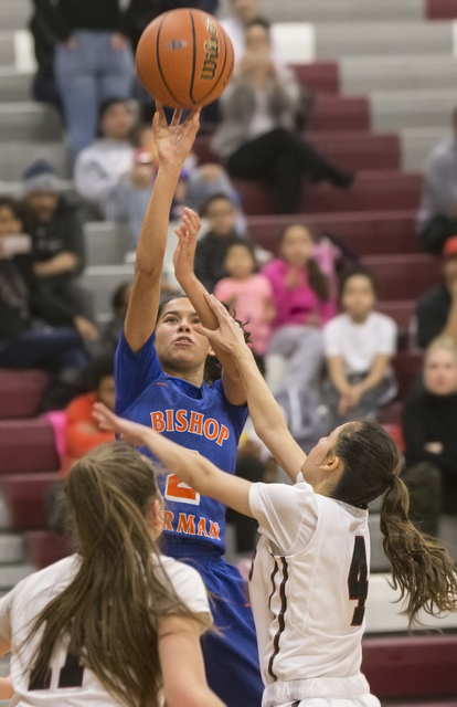 Bishop Gorman's Shaira Young (2) shoots a three point shot over Desert Oasis' (4) and Ashlynn Sharp (11) during the Gaels road matchup with the Diamondbacks on Tuesday, Jan. 10, 2017, at Desert Oa ...