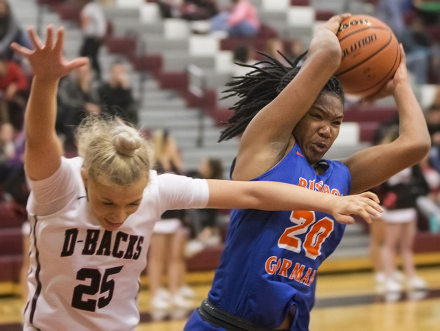 Bishop Gorman's Skylar Jackson (20) grabs a rebound over Desert Oasis' Melissa Simmons (25) during the Gaels road matchup with the Diamondbacks on Tuesday, Jan. 10, 2017, at Desert Oasis High Scho ...