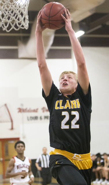 Clark's Trey Woodbury (22) converts a fast break layup during the Chargers road matchup with the Las Vegas Wildcats on Thursday, Jan. 12, 2017, at Las Vegas High School, in Las Vegas. Benjamin Hag ...