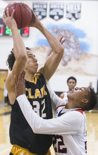 Clark's Ian Alexander (32) drives to the rim over Las Vegas' Zion Edwards (22) during the Chargers road matchup with the Wildcats on Thursday, Jan. 12, 2017, at Las Vegas High School, in Las Vegas ...