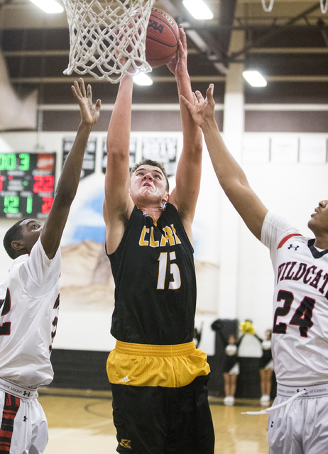 Clark's James Bridges (15) grabs a rebound over Las Vegas' Zach Matlock (24) and Kiaeem Gonzaque-Johnson (32) during the Chargers road matchup with the Wildcats on Thursday, Jan. 12, 2017, at Las  ...