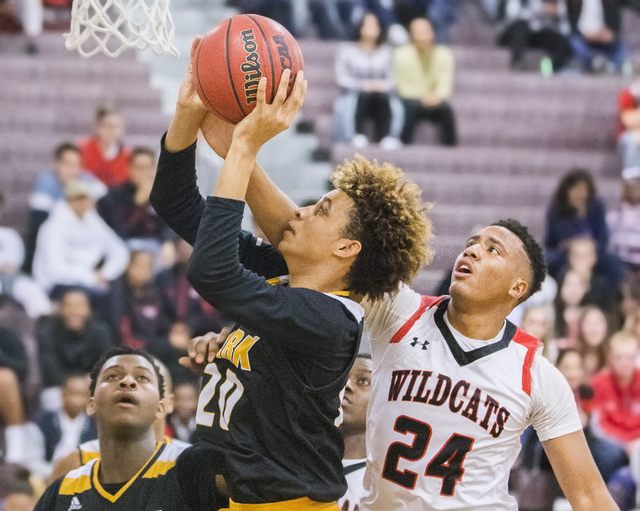 Clark's Jalen Hill (20) slashes to the rim past Las Vegas' Zach Matlock (24) during the Chargers road matchup with the Wildcats on Thursday, Jan. 12, 2017, at Las Vegas High School, in Las Vegas.  ...