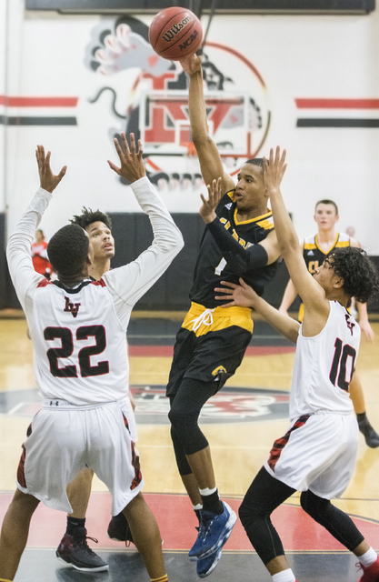 Clark's Sedrick Hammond (1) makes a no look pass through Las Vegas defenders  Zion Edwards (22) and Josh Valencia (10) during the Chargers road matchup with the Wildcats on Thursday, Jan. 12, 2017 ...