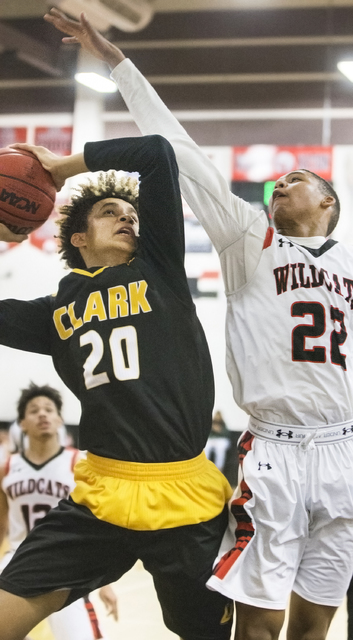 Clark's Jalen Hill (20) drives to the rim over Las Vegas' Zion Edwards (22) during the Chargers road matchup with the Wildcats on Thursday, Jan. 12, 2017, at Las Vegas High School, in Las Vegas. B ...
