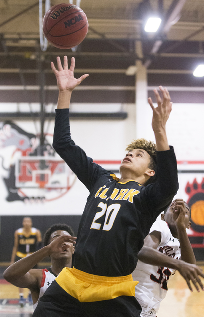 Clark's Jalen Hill (20) reaches for a rebound over Las Vegas' Kiaeem Gonzaque-Johnson (32) during the Chargers road matchup with the Wildcats on Thursday, Jan. 12, 2017, at Las Vegas High School,  ...