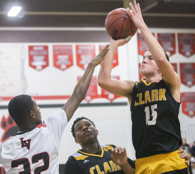 Clark's James Bridges (15) shoots a jump shot over Las Vegas' Kiaeem Gonzaque-Johnson (32) during the Chargers road matchup with the Wildcats on Thursday, Jan. 12, 2017, at Las Vegas High School,  ...