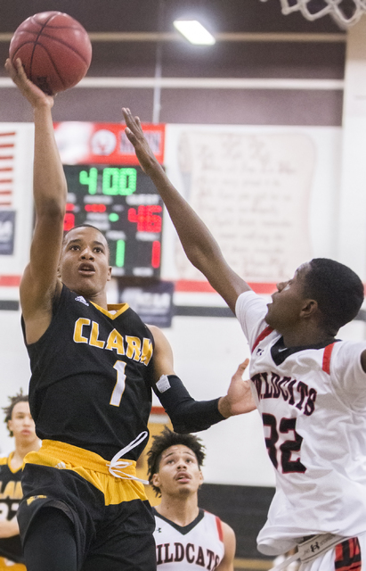 Clark's Sedrick Hammond (1) shoots over Las Vegas' Kiaeem Gonzaque-Johnson (32) during the Chargers road matchup with the Wildcats on Thursday, Jan. 12, 2017, at Las Vegas High School, in Las Vega ...