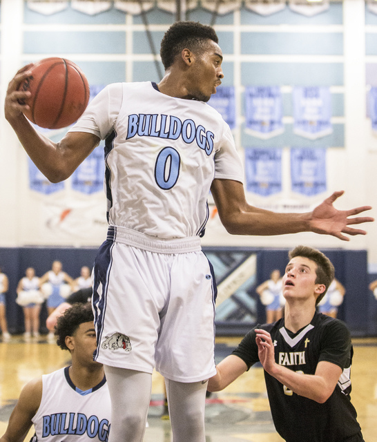 Centennial's Troy Brown (0) grabs a rebound over Faith Lutheran's Connor Nichols (22) during the Bulldog's home matchup with the Crusaders on Wednesday, Jan. 25, 2017, at Centennial High School, i ...