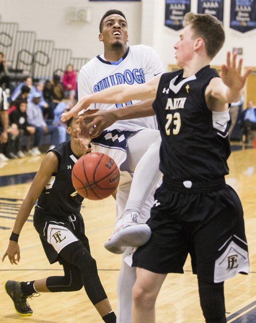Centennial's Troy Brown (0) gets fouled on the way to the basket by Faith Lutheran's Brevin Walter (23) during the Bulldog's home matchup with the Crusaders on Wednesday, Jan. 25, 2017, at Centenn ...