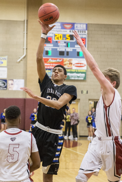 Sierra Vista's Mathias Aaiva (20) shoot over Desert Oasis' Manny Mitchell (5) on Tuesday, Dec. 13, 2016, at Desert Oasis High School, in Las Vegas. Benjamin Hager/Las Vegas Review-Journal