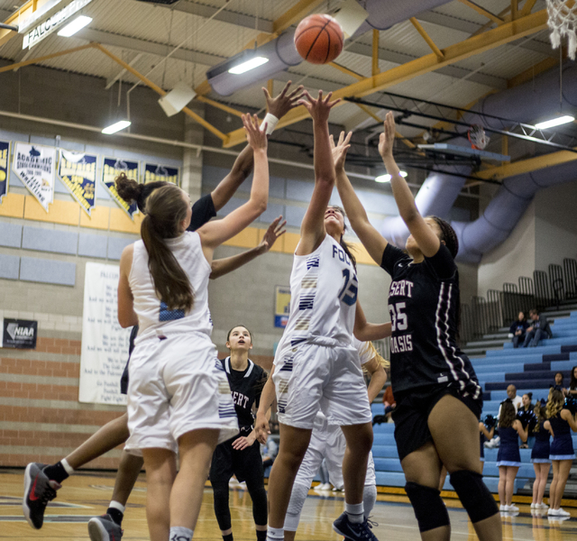 Players from Foothill and Desert Oasis jump for the ball during a game at Foothill High School, Wednesday, Nov. 30, 2016, in Henderson. Elizabeth Page Brumley/Las Vegas Review-Journal Follow @EliP ...