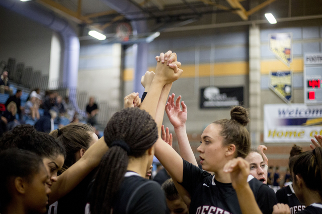 Players of Desert Oasis girls basketball team grasp hands after defeating Foothill 62-44 at Foothill High School, Wednesday, Nov. 30, 2016, in Henderson. Elizabeth Page Brumley/Las Vegas Review-Jo ...