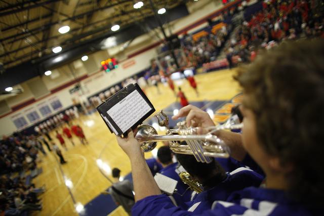 Bishop Gorman's Christian Strysniewiez plays the trumpet during a basketball game at Bishop Gorman High School on Tuesday, Dec. 6, 2016, in Las Vegas. (Rachel Aston/Las Vegas Review-Journal) @rook ...