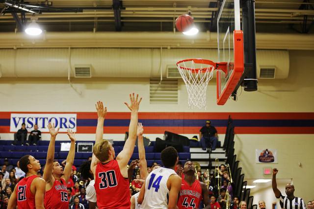 Both Bishop Gorman and Coronado teams wait to catch a rebound during a basketball game at Bishop Gorman High School on Tuesday, Dec. 6, 2016, in Las Vegas. (Rachel Aston/Las Vegas Review-Journal)  ...
