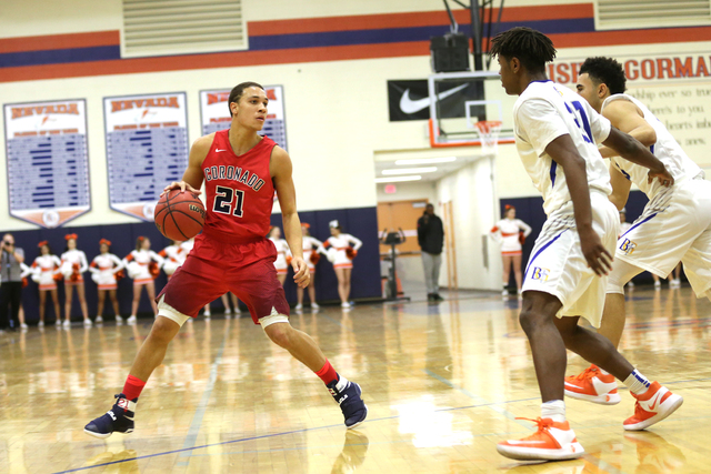 Coronado's Freddy Reeves (21) gets ready to pass Bishop Gorman players during a basketball game at Bishop Gorman High School on Tuesday, Dec. 6, 2016, in Las Vegas. (Rachel Aston/Las Vegas Review- ...