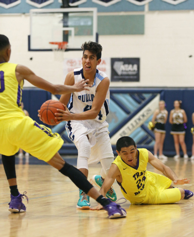 Centennial's Kamakana Winquist, center, gains posession of a loose ball past by Durango's Michael Diggins, left, and Apollo Corley, on Friday. Centennial won, 69-58. (Ronda Churchill/Las Vegas R ...