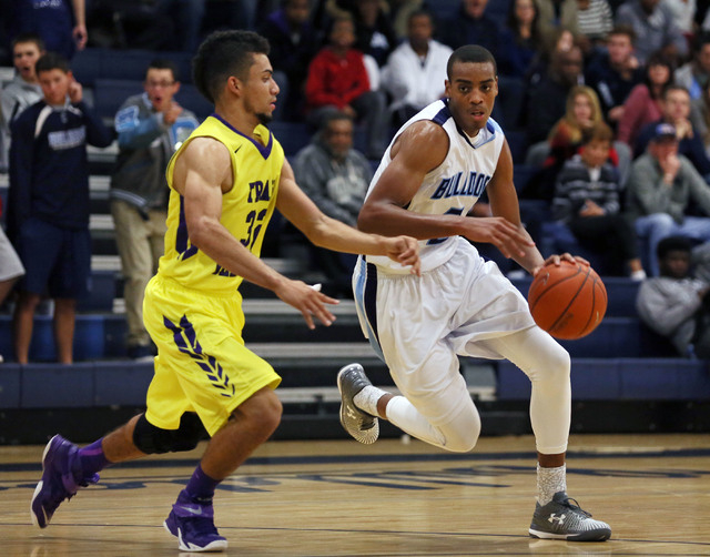Centennial's Troy Brown, right, drives the ball past Durango's Victor Ross on Friday. Centennial won, 69-58. (Ronda Churchill/Las Vegas Review-Journal)