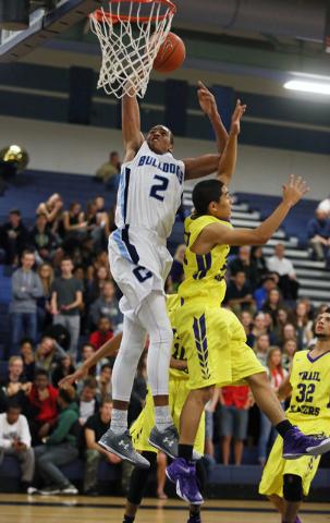 Centennial's Troy Brown (2) goes up for a shot over Durango's Apollo Corley on Friday. Centennial won, 69-58. (Ronda Churchill/Las Vegas Review-Journal)