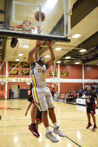 Clark's Ty'Rek Wells (13) goes up for a shot against Valley on Saturday. Wells had 14 points, seven rebounds and three blocked shots, but Valley won, 54-51. (Martin S. Fuentes/Las Vegas Review-Jou ...