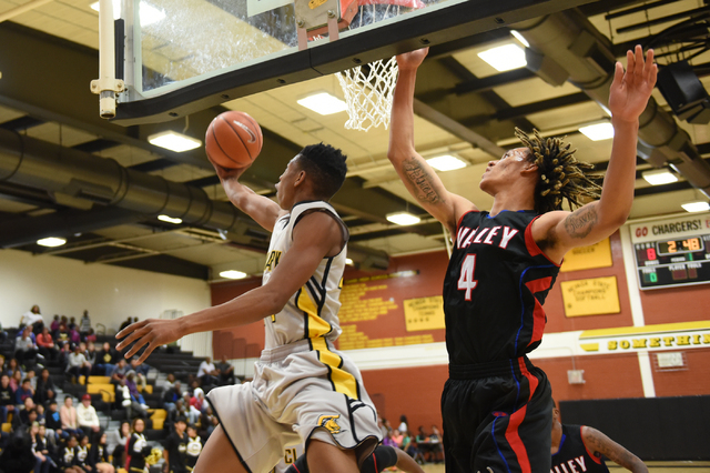 Clark's Darius Jackson (44) goes up for a shot against Valley Taveon Jackson (4) on Saturday. Valley won, 54-51. (Martin S. Fuentes/Las Vegas Review-Journal)