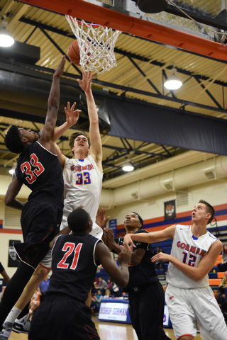 Bishop Gorman's Stephen Zimmerman (33) shoots the ball overCorona Centennial's Jalen Hill (33) during the third-place game of the Tarkanian Classic on Saturday. Zimmerman had 16 points, nine rebou ...