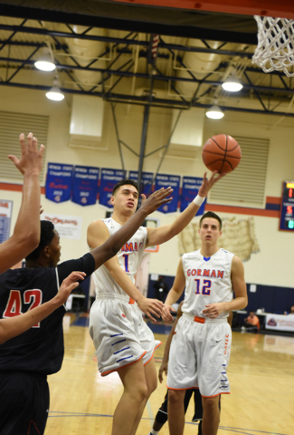 Bishop Gorman's Chase Noma'aea (1) shoots the ball over Corona Centennial defenders during the third-place game of the Tarkanian Classic on Saturday. Gorman won, 71-51. (Martin S. Fuentes/Las Vega ...