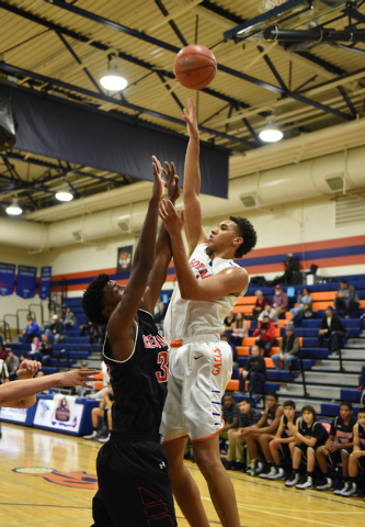 Bishop Gorman's Chase Jeter (4) shoots the ball over Corona Centennial's Jalen Hill (33) during the third-place game of the Tarkanian Classic on Saturday. Jeter had 16 points and 13 rebounds in a  ...