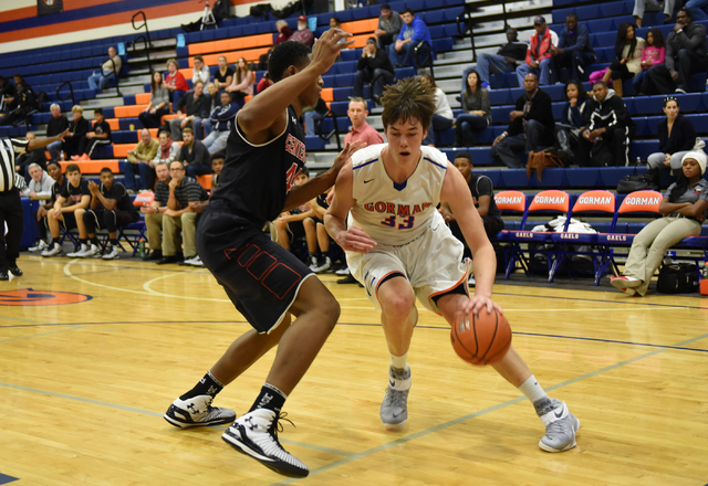 Bishop Gorman's Stephen Zimmerman (33) dribbles past Corona Centennial's Ike Anigbogu (44) during the third-place  game of the Tarkanian Classic on Saturday. Zimmerman had 16 points, nine rebounds ...