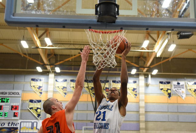 Foothill's Torrance Littles (21) goes up for a shot against National Prep Academy's Nenard Nerandzic (31) during the Foothill Holiday Classic championship game on Monday. Littles had 16 points and ...