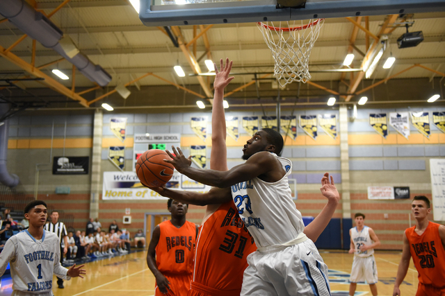 Foothill's Te'Vion Reed (20) goes up for a shot against National Prep Academy's Nenard Nerandzic (31) during the Foothill Holiday Classic  championship game on Monday. National Prep won, 65-54. (M ...