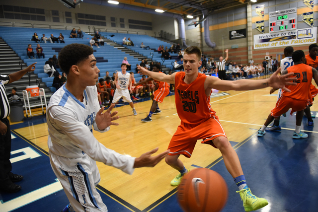 Foothill's Kevin Woodland (1), left, passes the ball past National Prep Academy's Raimond Tribuntsov (20) during the Foothill Holiday Classic championship game on Monday. Tribuntsov was the tourna ...